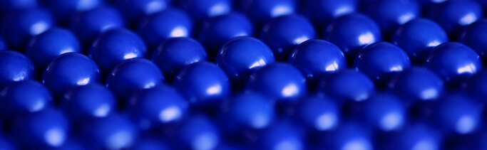 Blue metallic balls in a chain mail formation